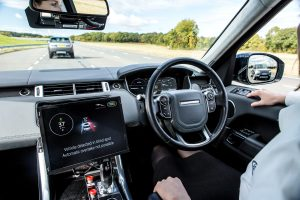 Jaguar Land Rover vehicle drives autonomously during an October 2016 UK Autodrive media day.