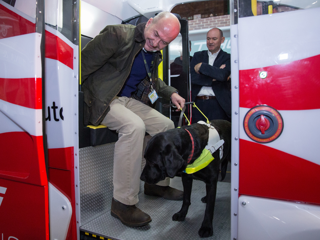 Clive Wood and his Labrador Winnie try out one of the pods before their December test ride